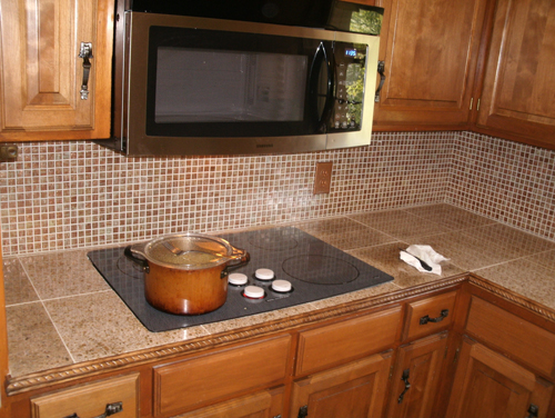 Kitchen Update With Ceramic Tile Countertop And Glass Tile